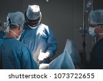group of surgeons using... | Shutterstock . vector #1073722655