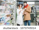 young woman pharmacist choosing ... | Shutterstock . vector #1073745014