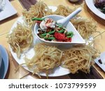 fried papaya salad serve in the ... | Shutterstock . vector #1073799599