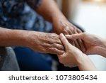 hand of older woman holding... | Shutterstock . vector #1073805434