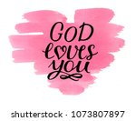 hand lettering god loves you on ... | Shutterstock . vector #1073807897