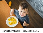 a child in a t shirt in the... | Shutterstock . vector #1073811617