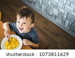 a child in a t shirt in the... | Shutterstock . vector #1073811629