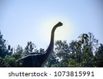 dinosaur is standing in jungle,with its long neck to easy eating leaf on higher tree,innovation of life in primitive age