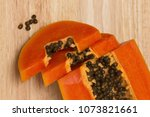 a papaya fruit is cut into... | Shutterstock . vector #1073821661