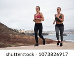 two pretty girls running in... | Shutterstock . vector #1073826917