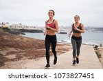 smiling young women running by...   Shutterstock . vector #1073827451