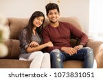cute happy young indian couple... | Shutterstock . vector #1073831051