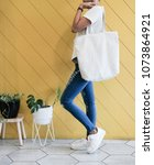 woman showing white totebag.... | Shutterstock . vector #1073864921