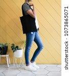 woman showing black totebag....   Shutterstock . vector #1073865071