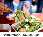 laos food at night market ... | Shutterstock . vector #1073868605