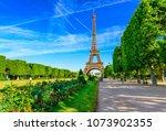 paris eiffel tower and champ de ... | Shutterstock . vector #1073902355