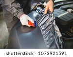 car wrapping specialist putting ... | Shutterstock . vector #1073921591