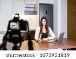 young female vlogger recording... | Shutterstock . vector #1073921819