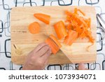 chef peel and chop carrot  ... | Shutterstock . vector #1073934071