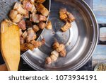 chef putting cooked streaky... | Shutterstock . vector #1073934191