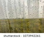 the rain falls on the glass ... | Shutterstock . vector #1073942261