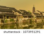 qiandeng ancient town... | Shutterstock . vector #1073951291