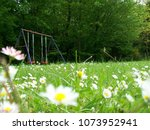 low angle view of a swing set ... | Shutterstock . vector #1073952941