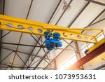 hoist of industrial overhead... | Shutterstock . vector #1073953631