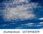 white  and grey cirrostratus... | Shutterstock . vector #1073958359