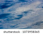white  and grey cirrostratus... | Shutterstock . vector #1073958365