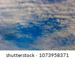 white  and grey cirrostratus... | Shutterstock . vector #1073958371