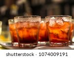 close up on cocktail glasses on ... | Shutterstock . vector #1074009191