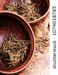 Small photo of Traditional folk remedy from valerian roots in a mortar