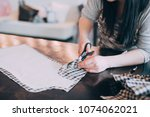tailor girl cuts cloth with...   Shutterstock . vector #1074062021