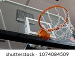 Small photo of MABA, Kuala Lumpur, Malaysia - April 21, 2018 : Picture of a basket ball hoop taken during half time game in an indoor basketball court.