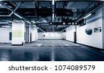 empty underground parking garage | Shutterstock . vector #1074089579