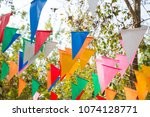 Colorful Bunting In Outdoor...