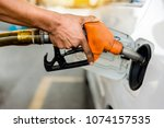 car refueling on petrol station.... | Shutterstock . vector #1074157535