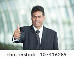 Indian Business man with his Thumb Up in agreement - stock photo