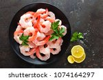 prawns on plate. shrimps ... | Shutterstock . vector #1074164297