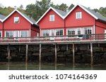 fishing lodges on water.   Shutterstock . vector #1074164369