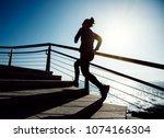 sporty female runner running... | Shutterstock . vector #1074166304