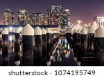 docklands pilings in front of... | Shutterstock . vector #1074195749