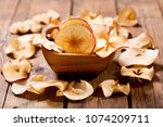 dried apples in a bowl on... | Shutterstock . vector #1074209711
