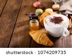 cup of cappuccino coffee with... | Shutterstock . vector #1074209735
