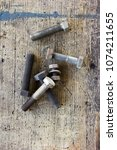 old  dirty screws against... | Shutterstock . vector #1074211655