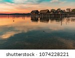 colorfull sunset at lake... | Shutterstock . vector #1074228221