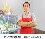 smiling ice cream store... | Shutterstock . vector #1074231311
