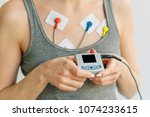 woman wearing holter monitor... | Shutterstock . vector #1074233615