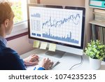 home trader analyzing forex ... | Shutterstock . vector #1074235235