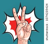 comic hand showing victory... | Shutterstock .eps vector #1074235424