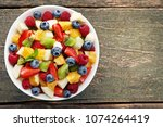 fresh fruit salad in bowl on... | Shutterstock . vector #1074264419