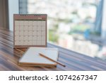 notebook with pencil diary on... | Shutterstock . vector #1074267347