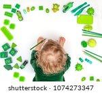 kid drawing on floor on paper.... | Shutterstock . vector #1074273347
